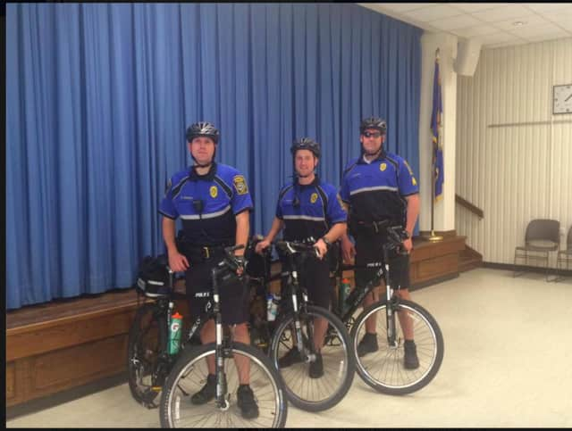 Trumbull Police Sgt. Chris Barton and Officers Michael Edwards and Blake Petty showed off their bicycle equipment on Bicycle Safety Day.