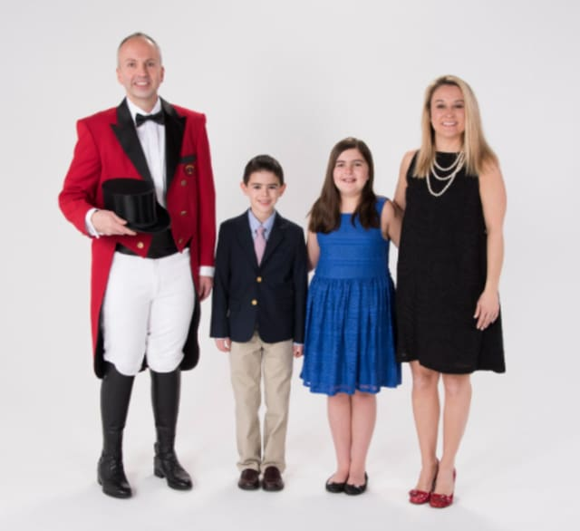 Jason Julian, left, will be the Ringmaster for this year's Barnum Festival. With him are wife, Tammy, and children Madison and Logan.