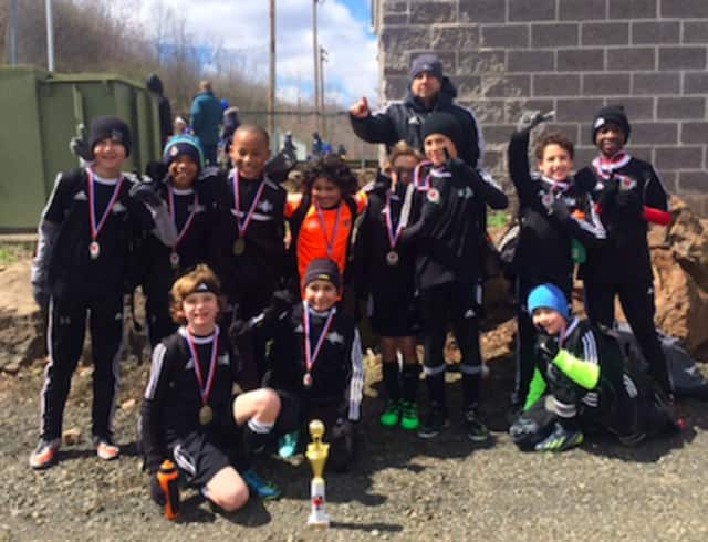 Members of the Stamford Youth Soccer League's Stamford FC U11 Boys' Premier Team who played in the South Central Premier Spring Kick-Off Classic, pictured with their coach, Quality Touch Soccer Academy's Jason Segovia.