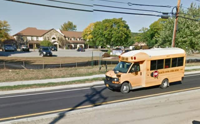 A school bus makes its way to Arlington High School.