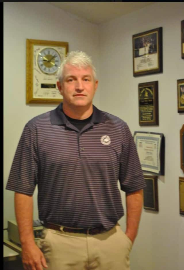 Danbury High School's head wrestling coach Ricky Shook -- a former wrestler and graduate of Danbury High School -- has been named to the Connecticut High School Coaches Association Hall of Fame.