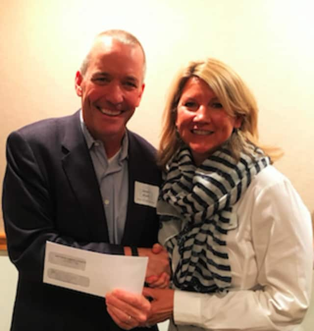 Jim Bosek, Shelter for the Homeless board chair, with New Canaan Community Foundation board member Kay Linneman after receiving a $12,500 grant to support the shelter's emergency meals program.
