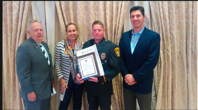 Officer Mark Caswell was recently recognized as the Ridgefield Police Department's Officer of the Year. See story for photo Identifications.