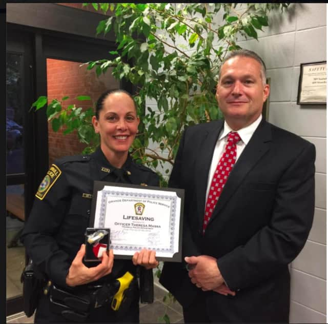 The Orange Police Department honored Trumbull Police Officer Theresa Massa with a Life Saving award for her efforts in saving a choking victim while off duty at Outback Steakhouse.