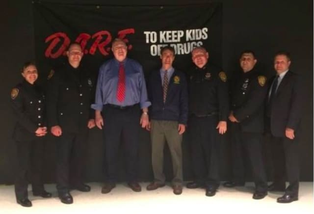 From left, Officer Elizabeth Muckell, Officer Daniel Ryan, Councilman Dnis Troy, Supervisor Andy Stewart, Chief Kevin Nulty, Officer Brandon Myers and Captain Donald Butterworth at the 2016 D.A.R.E. Graduation.