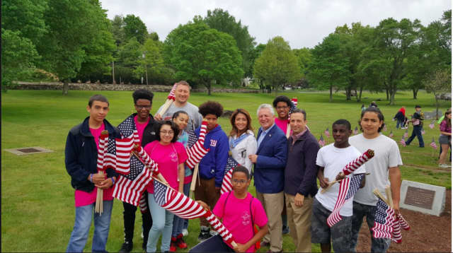 Members of the Norwalk Youth Group and Norwalk Police Department spent the day placing American Flags on graves following the Flag Ceremony at Riverside Cemetery.