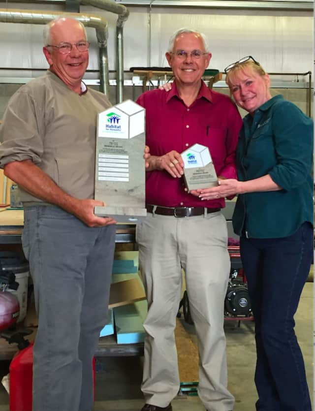 Habitat for Humanity of Coastal Fairfield County (Habitat CFC) honored Mize Johnson, center, at its recent annual Volunteer Recognition Event. He is flanked by Frank and Eileen Bakos.
