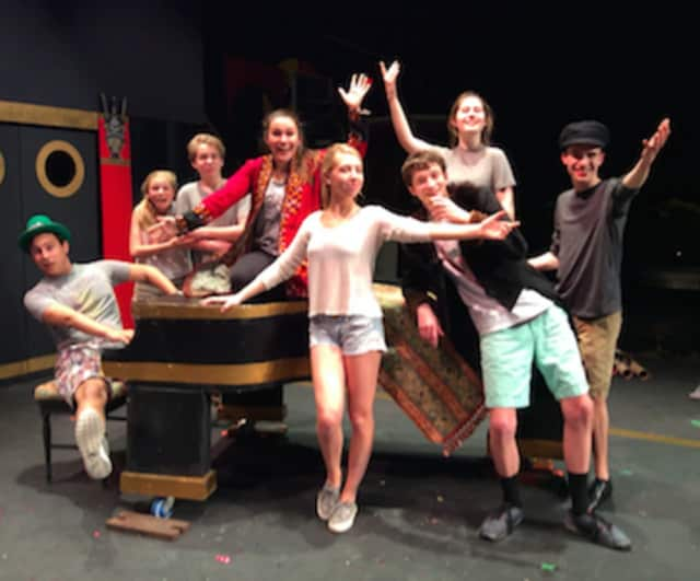 """The New Canaan High School act two cast from """"A Day in Hollywood, A Night In the Ukraine"""" are shown, from left, Nick Ranieri, Lucy Coutts, Wyatt Lysenko, Kate Callahan, Audrey Kirkpatrick, Joseph Turner, Allison Demers and Will Dooley."""