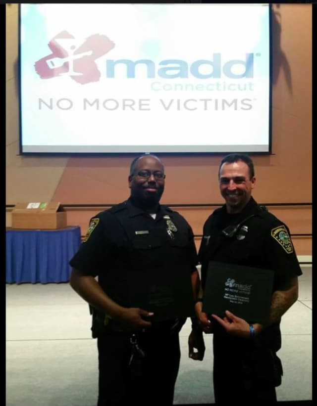 From left, Norwalk Police Officers Tyrone Boyd and Chris Wasilewski are 2016 MADD Award recipients, along with Sgt. Jim Mosher (not pictured).