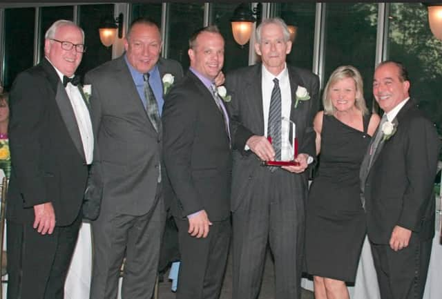 The Westchester County Signature Building Team of the Year Award for managing a building in White Plains was awarded to, from left, Joseph Roccuzzo, Kevin Ullrich, Robert Melly, Caroline Molloy, and Anthony Lifrieri, of Cushman & Wakefield.