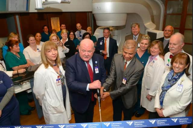 Greenwich Hospital President Norman G. Roth (left) and radiation oncologist Ashwatha Narayana cut the ribbon during a ceremony to unveil the new TrueBeam radiation therapy system.