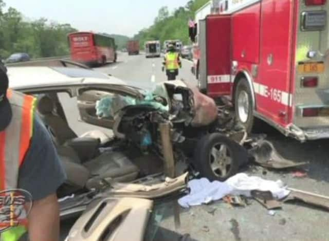A car collided with with a firetruck on I-87 in Ardsley on Friday.