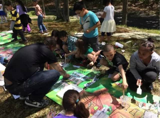 Woodside Elementary School students in Peekskill collaborate on a mural with artists. The artwork will be open for public viewing June 4.