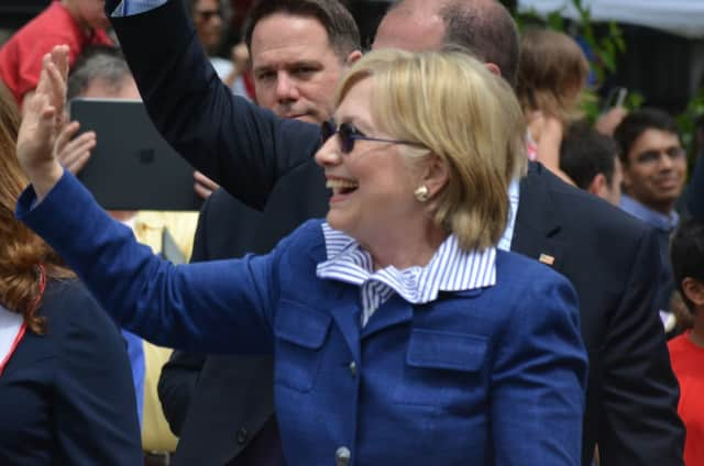 Hillary Clinton waves as she marches in the town of New Castle's 2016 Memorial Day parade, which went through downtown Chappaqua.