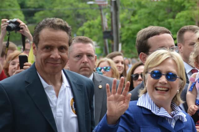 Gov. Andrew Cuomo, who lives in the northern side of town, marches with fellow New Castle resident, Chappaqua's Hillary Clinton, in New Castle's Memorial Day parade.