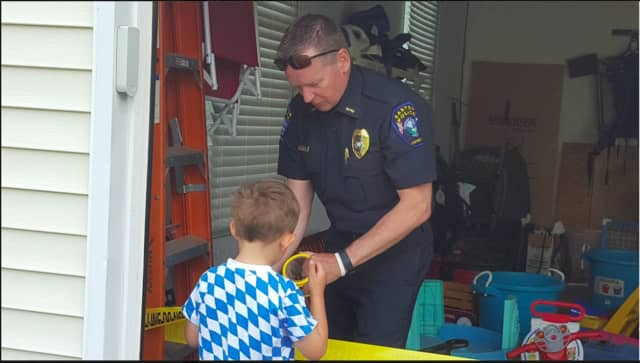 Easton Police Department Chief Tim Shaw with a preschool student.
