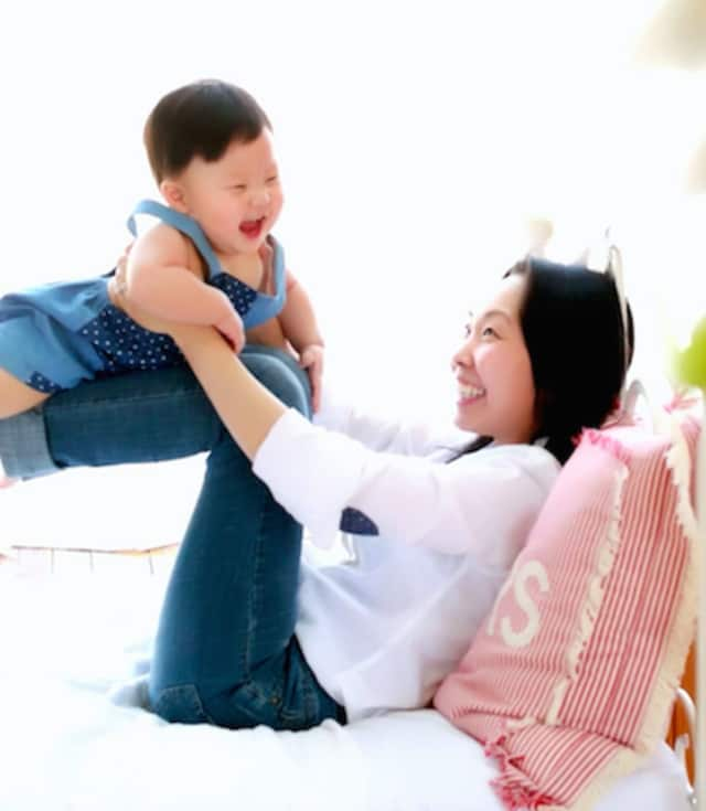 Concert pianist Jeehyun Rachel Kim and her son, Daniel, who is No. 38 on the voting booth for the Beautiful Baby contest.