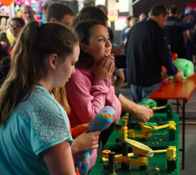 Girls play games at the St. Mary's Carnival in Dumont.