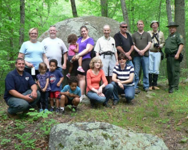 National Trails Day: David Solek, right, Monroe's park ranger and tree warden, lines up with National Trails Day hikers in front of Whale Rock on Monroe's Chalk Hill Nature Trail.