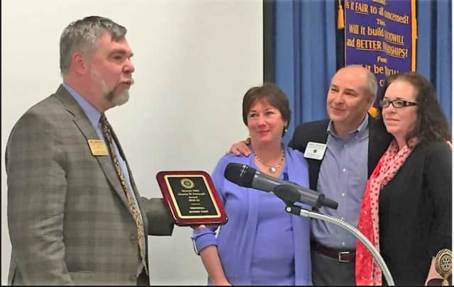The Trumbull Rotary Club was honored with the Charles W. Pettingill Award. Accepting this award from District Governor Elect Paul Mangels are the club's three immediate past presidents: Holly Sutton-Darr, Jim Malski and Karen DelVecchio.