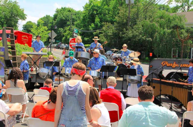 A band performs at a previous Georgetown Day, which will be held Sunday. Coldwell Banker of Ridgefield will host a booth at the event.