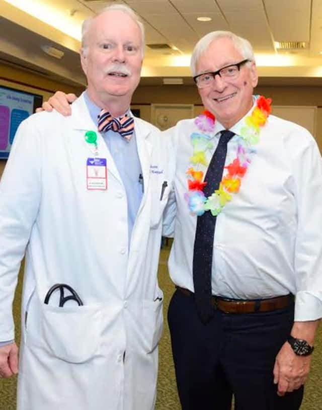"Dickerman Hollister, MD, presented Paul Waters, MD, (right) with the 2016 Oncology Service Line Award at Greenwich Hospital's ""Sailing into Survivorship"" celebration, which drew nearly 130 former patients, volunteers and staff."