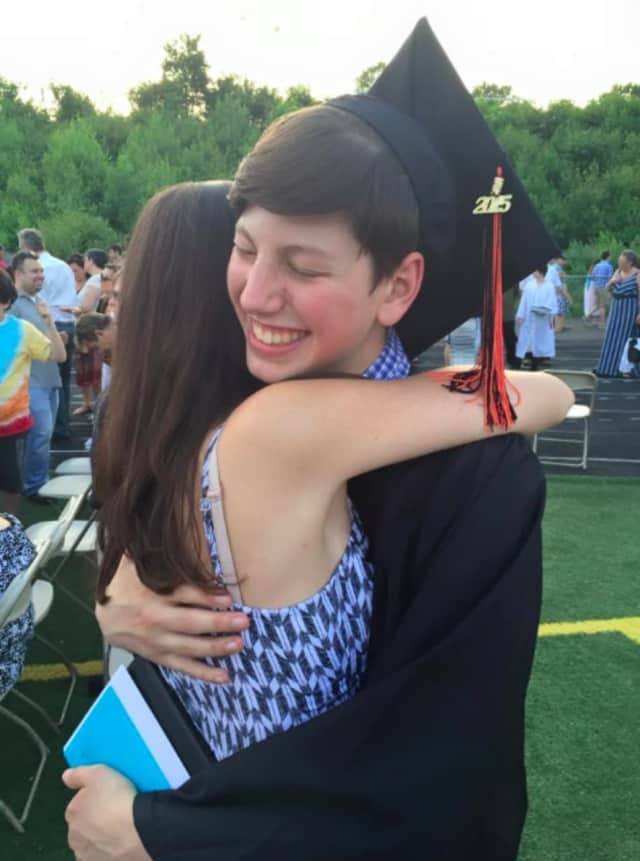 A happy Shelton High School graduate celebrates at the 2015 Commencement.