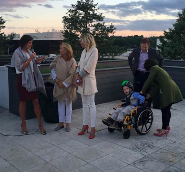 "From left: Brooke Bohnsack, Gina Filippelli, Julie Rivard and the Wish Family: Sam Buck (Wish Kid), Allyson Buck and Nicholas Buck. Make-A-Wish Connecticut and the Wishes Ball Committee recently hosted ""Rose' on the Rooftop"" in Greenwich."