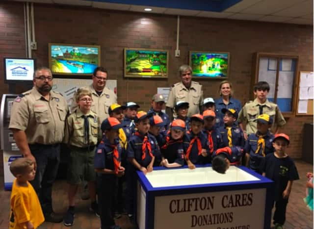 Clifton Cub Scout Pack constructed and donated a collection box for Clifton Cares, a group that collects donations for troops.