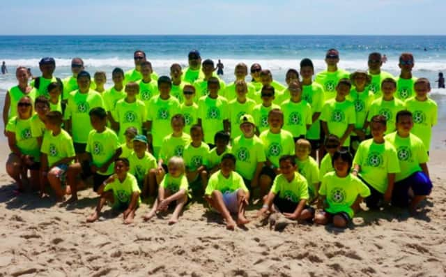 Soccer players from North Arlington pose on the beach in Seaside Heights.