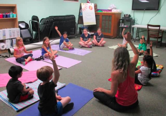 A youth summer yoga camp will be held July 11-15 at A Common Ground Community Arts Center in Danbury.