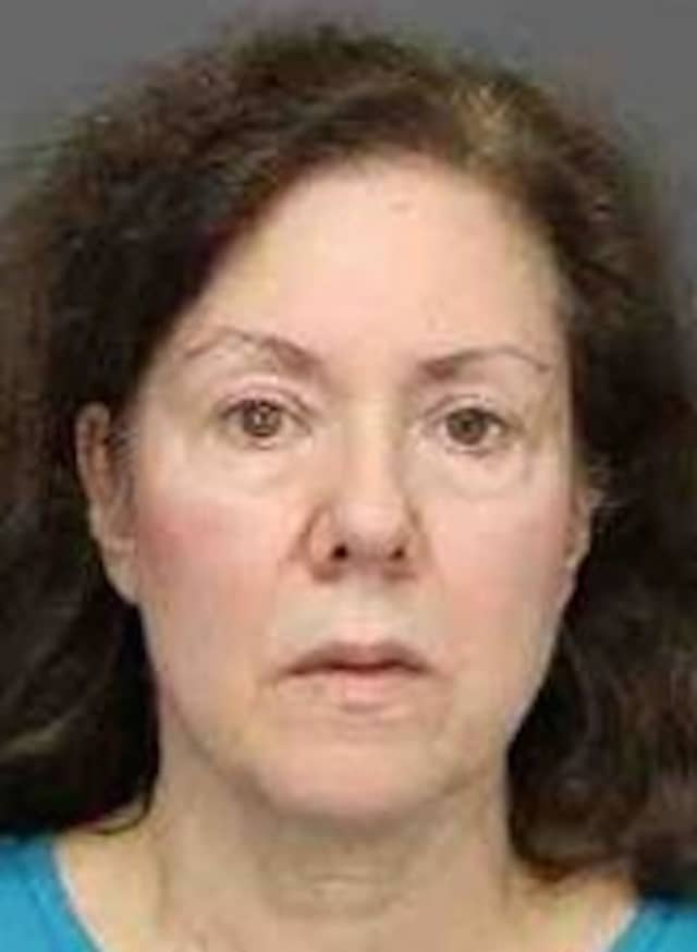 June Ann Swartz, a former Harrison High School teacher, allegedly owes more than $11,000 in state taxes, according to Westchester County prosecutors.