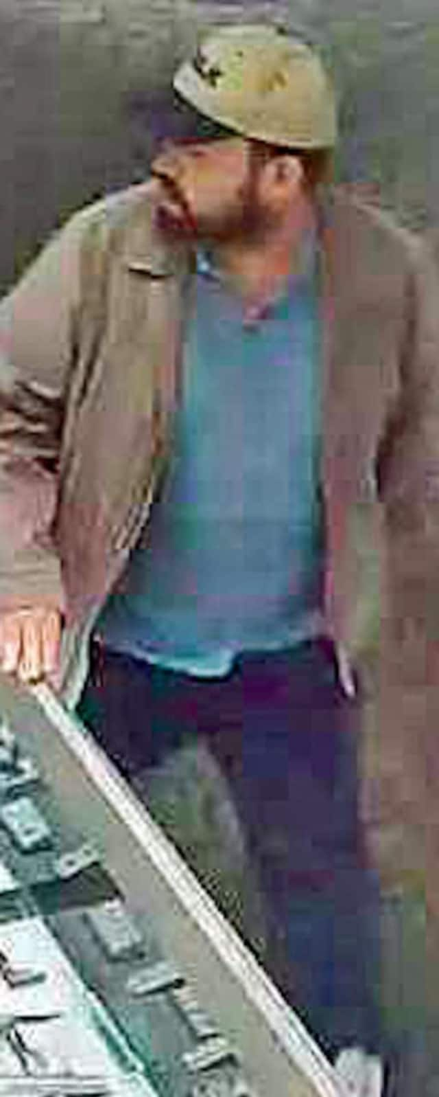 Port Chester police released this image of an armed robbery suspect who stole nearly $13,000 in gold and diamond rings on Monday night at Kay/Sterling Jewelers at The Waterpfront at Port Chester.