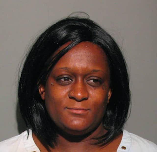 Shavonne Cox-Eleuthere, 33, of 147 Belmont Ave., Springfield, Mass., was charged by New Canaan Police with using stolen credit cards.