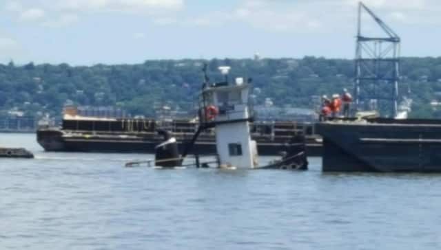 A tugboat sinks in the Hudson River near the Tappan Zee Bridge early Thursday afternoon.
