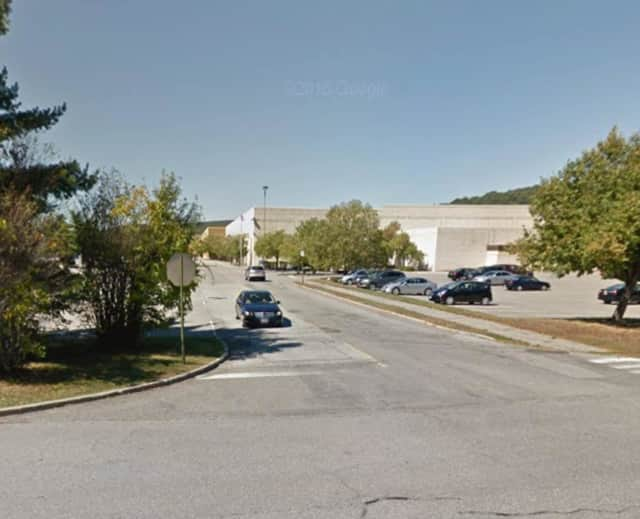 Yorktown police arrested a 37-year-old Ossining woman Thursday after Sears employees said she tried to leave the store without paying for clothes valued at $265, police said.