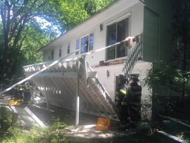 Four people were injured Monday when this deck collapsed during a Fourth of July celebration.