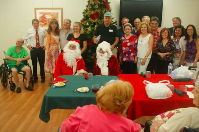 """Residents, along with their families, who attend """"Christmas in July"""" will enjoy live entertainment, a Christmas sing-a-long, gifts and a visit from Santa."""