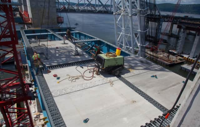 Crews work to construct the main span of the new Tappan Zee Bridge.