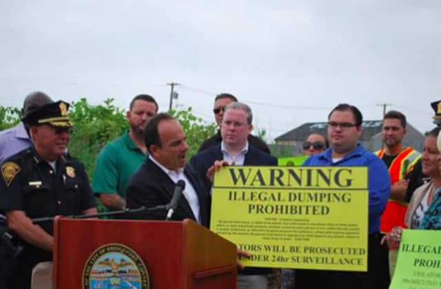 Mayor Joe Ganim announces a new $200 reward for tips that lead to an arrest on blight and illegal dumping charges in Bridgeport.