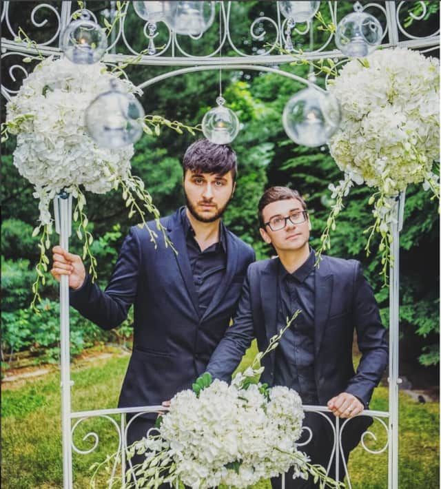 Musician Brad Walsh and fashion designer Christian Siriano hold their wedding ceremony at the summer home in Danbury.