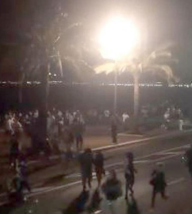 Bastille Day revelers in Nice, France run for cover after a truck rammed through the crowd Wednesday.