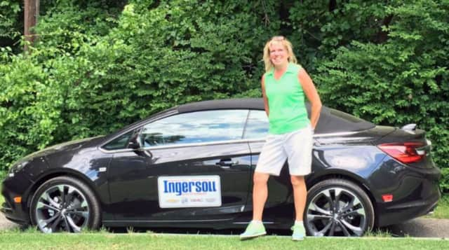 Sharon Bodner standing with her new 2016 Buick Cascada.