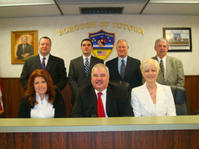 Mayor John Coiro (center) and the Totowa Borough Council.