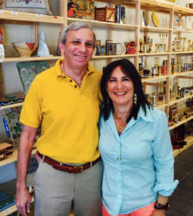 Karen Schecter, right, and her husband Jay, opened their Mount Kisco business, The Aesthetic Sense: Goods for the Soul, last year.