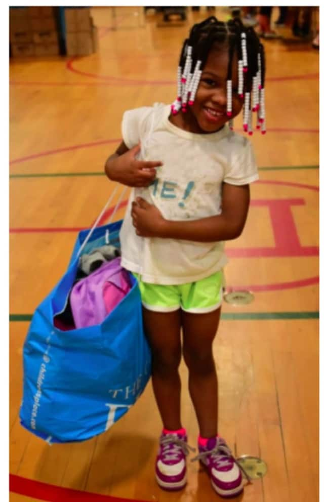 A happy shopper attended last year's event to stock on school supplies and clothes.