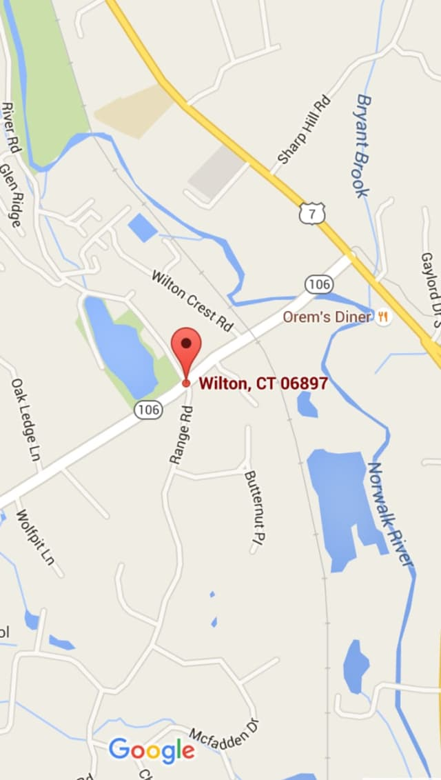 Wolfpit Road is closed Tuesday evening at Range Road in Wilton.