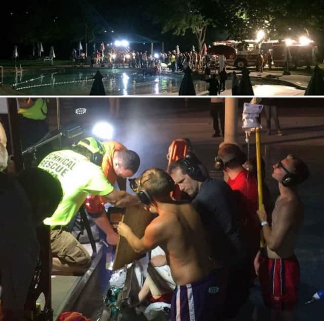 Using spotlights and special extrication tools, Valhalla firefighters and other rescue crews cut a section of the Mount Pleasant Town Pool wall to free a boy whose finger got stuck. (A photo of the illuminated pool is shown above the rescue image.)