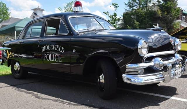 "A 1951 Ford from the Ridgefield Police Department received the trophy for ""Best Original"" at last weekend's Cruising For Justin car show in Ridgefield."