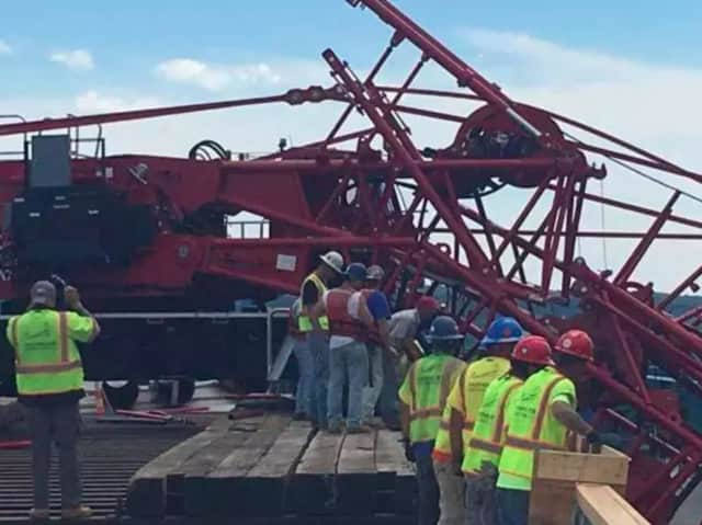 Construction workers investigate the collapse of a crane at the Tappan Zee Bridge on Tuesday.